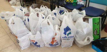 סלי מזון של עזרת אחים (צילום: פרטי)